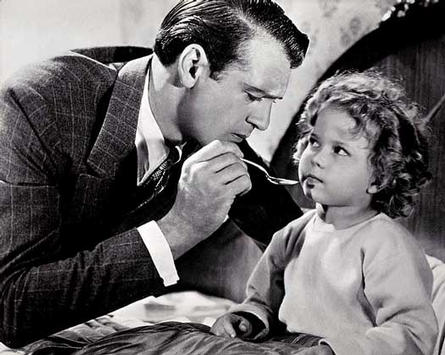 Shirley Temple and Gary Cooper in the movie Taxi Driver (1934)
