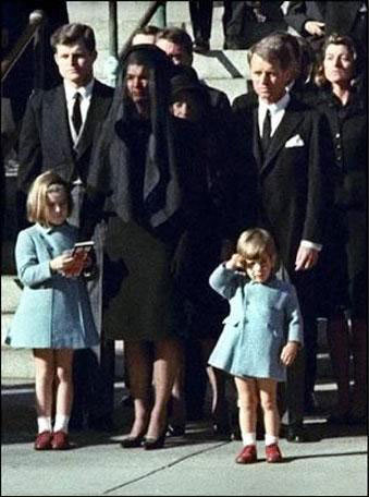November 25, 1963. Kennedy's funeral. John F. Kennedy Jr. salutes his father's coffin.